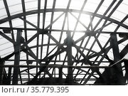 Sun shines through the lattice structures of the covered pedestrian crossing. Стоковое фото, фотограф Евгений Харитонов / Фотобанк Лори