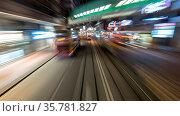 Tarveling through night Hong Kong by double-decker tram. View to ... Стоковое фото, фотограф Zoonar.com/Danil Roudenko / age Fotostock / Фотобанк Лори