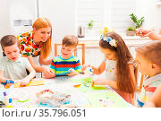 Mother smiles while looking at son's greeting card made with his hands. Стоковое фото, фотограф Zoonar.com/Oksana Shufrych / easy Fotostock / Фотобанк Лори