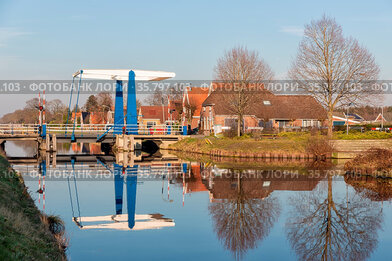 Farmhouses and drawbridge over canal near Smilde in Drenthe, The Netherlands...