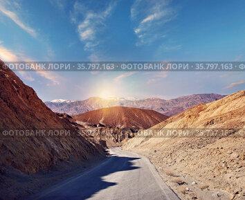 Desert road leading through Death Valley National Park, California...