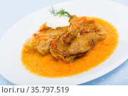 Homemade cabbage rolls in leaves of cabbage at plate with sour cream. Стоковое фото, фотограф Яков Филимонов / Фотобанк Лори