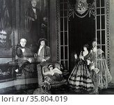 Her husband's aristocratic ancestors look sneeringly at the humbly born heroine in this 'vision scene' from Saturday night, 1922. Редакционное фото, агентство World History Archive / Фотобанк Лори