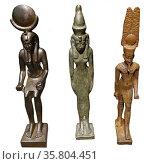 Left to right: Khonsu, Mut and Amun; gods of ancient Egypt. Редакционное фото, агентство World History Archive / Фотобанк Лори