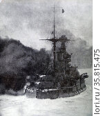 Photograph of British battle cruiser firing a gun. Редакционное фото, агентство World History Archive / Фотобанк Лори