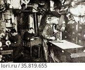 Photograph taken during  WWI showing sleeping and working quarters in the same space. Редакционное фото, агентство World History Archive / Фотобанк Лори
