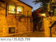 The old Jerusalem neighborhood of Mishkenot Shaananim or Yamin Moshe in the evening illumination. Israel (2017 год). Стоковое фото, фотограф Наталья Волкова / Фотобанк Лори