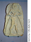 Limestone Wall Plaque of a Magical Spirit with Water Flowing from a Vessel 2000 B.C. From Ur. Редакционное фото, агентство World History Archive / Фотобанк Лори