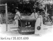 Korean noble boy carried by servants in a sedan chair 1900. Редакционное фото, агентство World History Archive / Фотобанк Лори