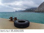 View from the pier from Sudak towards the Novyy Svet, Crimea. Cloudy... Стоковое фото, фотограф Zoonar.com/Sergey Rybin / age Fotostock / Фотобанк Лори