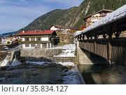A bridge over a small river in the ski resort of Mayrhofen, Tyrol... Стоковое фото, фотограф Zoonar.com/Sergey Rybin / age Fotostock / Фотобанк Лори