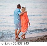 Senior couple walking together along the coast. Man embracing the... Стоковое фото, фотограф Zoonar.com/Danil Roudenko / age Fotostock / Фотобанк Лори