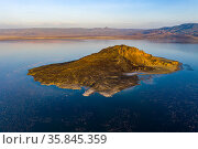 Aerial view of island and Lesser flamingo (Phoeniconaias minor) in lake Logipi, Suguta Valley, Kenya. February 2020. Стоковое фото, фотограф Denis-Huot / Nature Picture Library / Фотобанк Лори