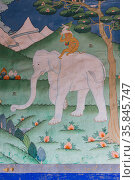 Buddhist artwork of Elephant and rider with rabbit and bird. Trongas Dzong. The largest fortress in Bhutan. September 2013. Стоковое фото, фотограф Jeff Foott / Nature Picture Library / Фотобанк Лори