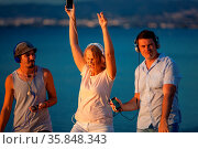 Group of three young people feeling free, enjoying life and excited... Стоковое фото, фотограф Zoonar.com/Danil Roudenko / age Fotostock / Фотобанк Лори