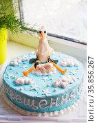 Bright blue baptized cake with baby and stork. Стоковое фото, фотограф Zoonar.com/Sergiy Artsaba / easy Fotostock / Фотобанк Лори