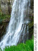 Akarmara, Abkhazia - May 6, 2021: Mountain cascade waterfall. Falls Velikan. People under the waterfall. The highest waterfall in Abkhazia. Стоковое фото, фотограф Григорий Стоякин / Фотобанк Лори