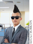 Well-dressed young man with Mohawk and sunglasses. Стоковое фото, агентство Ingram Publishing / Фотобанк Лори
