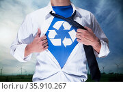 Businessman with open short revealing shirt with recycling symbol underneath. Стоковое фото, агентство Ingram Publishing / Фотобанк Лори
