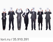 Medium group of business people in a row holding up paper with question mark, obscured face, studio shot. Стоковое фото, агентство Ingram Publishing / Фотобанк Лори