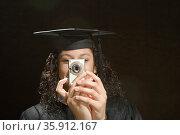 Female graduate taking a photograph. Стоковое фото, фотограф Shannon Fagan / Ingram Publishing / Фотобанк Лори