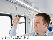 Commuter on light rail. Стоковое фото, фотограф Shannon Fagan / Ingram Publishing / Фотобанк Лори