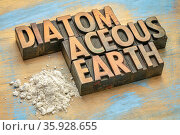 Food grade diatomaceous earth supplement - small pile of powder on... Стоковое фото, фотограф Zoonar.com/Marek Uliasz / easy Fotostock / Фотобанк Лори