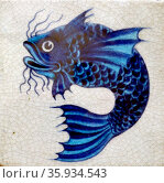 Earthernware tile with fish pattern. Редакционное фото, агентство World History Archive / Фотобанк Лори