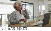 African american senior woman medicine in front of laptop at home. Стоковое видео, агентство Wavebreak Media / Фотобанк Лори