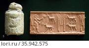 Calcite cylinder seal with animal-shaped knob from the Late Uruk period. Редакционное фото, агентство World History Archive / Фотобанк Лори
