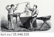 Glass blower's assistant bringing more glass from furnace to form foot of a vessel. (ca 1870) (2016 год). Редакционное фото, агентство World History Archive / Фотобанк Лори