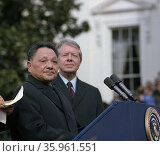 Deng Xiaoping and Jimmy Carter at the Chinese Vice Premier's arrival ceremony. Редакционное фото, агентство World History Archive / Фотобанк Лори