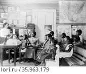 Photograph of young students in a classroom at the Tuskegee Normal Industrial Institute. Редакционное фото, агентство World History Archive / Фотобанк Лори