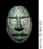 Face of the Maya Sun God carved in a green stone, Редакционное фото, агентство World History Archive / Фотобанк Лори