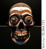 Decorated ancestor skull from the island of New Britain, Редакционное фото, агентство World History Archive / Фотобанк Лори
