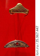 Pommel cap, with filigree-decoration in cloisonné garnets, from the Staffordshire Hoard. Anglo-Saxon. 7th or 8th centuries. Редакционное фото, агентство World History Archive / Фотобанк Лори