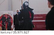 RUSSIA, KAZAN 24-04-2021: Kendo tournament indoors - japanese martial art - men in black traditional clothes fighting each other with bamboo sticks. Редакционное видео, видеограф Константин Шишкин / Фотобанк Лори