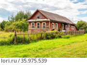 Old abandoned rural wooden house in russian village. Summer sunny... Стоковое фото, фотограф Zoonar.com/Alexander Blinov / easy Fotostock / Фотобанк Лори