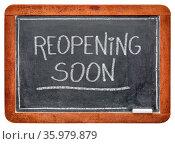 Reopening soon - white chalk handwriting on a slate blackboard, business... Стоковое фото, фотограф Zoonar.com/Marek Uliasz / easy Fotostock / Фотобанк Лори