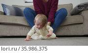 Close up of caucasian baby crawling on the floor at home. Стоковое видео, агентство Wavebreak Media / Фотобанк Лори