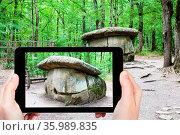 Travel concept - tourist photographs of the prehistoric large Shapsugsky... Стоковое фото, фотограф Zoonar.com/Valery Voennyy / easy Fotostock / Фотобанк Лори