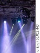 Spotlights and laser beams. Concert light. Stage lights. Soffits. Стоковое фото, фотограф Евгений Ткачёв / Фотобанк Лори