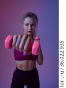 Young sportswoman with dumbbells poses in studio. Стоковое фото, фотограф Tryapitsyn Sergiy / Фотобанк Лори