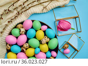 Colorful easter eggs and floral decoration. Стоковое фото, фотограф Tryapitsyn Sergiy / Фотобанк Лори