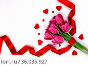 Valentines day hearts and pink tulip flowers isolated on white background... Стоковое фото, фотограф Zoonar.com/Ivan Mikhaylov / easy Fotostock / Фотобанк Лори