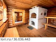 Interior of the Russian traditional wooden bath with brick stove. Стоковое фото, фотограф Zoonar.com/Alexander Blinov / easy Fotostock / Фотобанк Лори