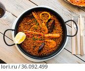 Appetizing seafood dish Paella with shrimp. Стоковое фото, фотограф Яков Филимонов / Фотобанк Лори