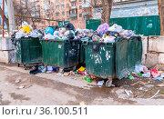 Samara, Russia - March 26, 2017: Opened green plastic recycling containers... Стоковое фото, фотограф Zoonar.com/Alexander Blinov / easy Fotostock / Фотобанк Лори