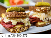 Reuben sandwich on rustic wood. Стоковое фото, фотограф Zoonar.com/Bernd Juergens / easy Fotostock / Фотобанк Лори