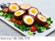 Scotch eggs with tomatoes, greens and leek, traditional Scottish cuisine. Стоковое фото, фотограф Яков Филимонов / Фотобанк Лори